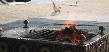 A portable fire being used in the desert