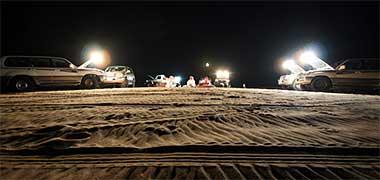 A group of Qataris enjoying the nighttime desert
