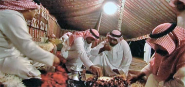 Guests eating a traditional meal in a tent
